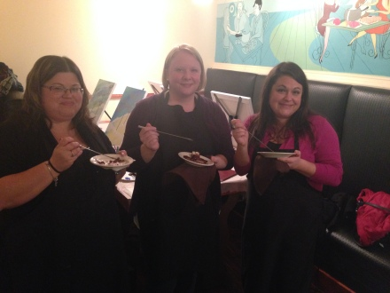 Three ladies enjoy their chocolate desserts during a break from the painting lesson!