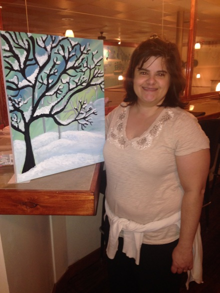 Denise McGrity shows a winter themed painting for an event at The Fondue Factory, Morgantown, WV.